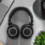 over ear headphone on a desk