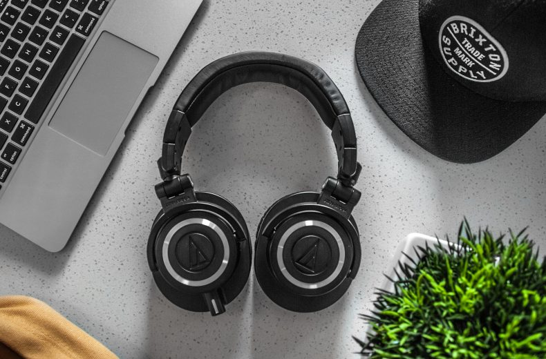 over ear headphone on a desk