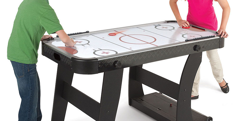 Children playing on a Air Hockey Table