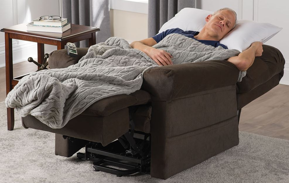 man sleeping in recliner in living room