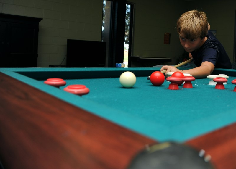 Kid Plays Bumper Pool Close Up