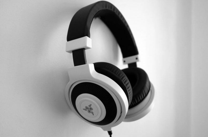 Black and White Razer Gaming Headset Hanging on Wall