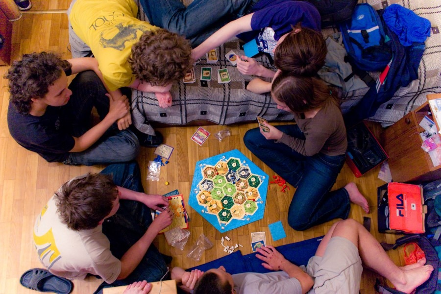 Friends Playing Settlers of Catan
