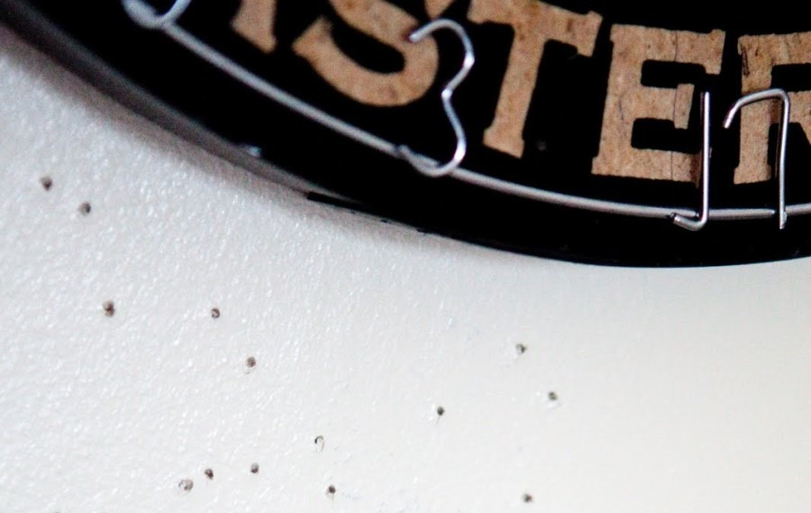 dart holes in wall close up